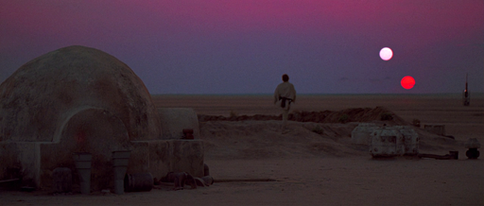 Binarni zalazak Sunca na Tatooineu, fiktivnom planetu iz Star Wars-a. Izvor: Wikimedia Commons.